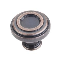 This brushed oil rubbed bronze finish round cabinet knob with plain design is a part of the Lafayette Series from Jeffrey Alexander. A perfect blend of craftmanship in traditional and contemporary design to complement any decor.