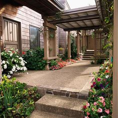 Indirect Pergola Attachment -   There's no law that says the route from house to pergola has to be a straight line. The small porch overhang at the rear door branches sideways to an arbor, which in turn has an offset connection to the pergola. The result is unexpected and interesting