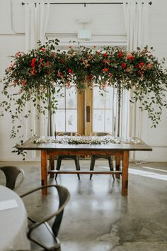 This Southern Wedding at Sainte Terre Nailed the Bride's Farmhouse Whimsy Style This sweetheart table featured a rustic table with industrial chairs + a rose-filled floral installation Wedding Reception Backdrop, Wedding Ceremony Flowers, Wedding Table, Floral Wedding, Hanging Flowers Wedding, Ceremony Backdrop, Wedding Receptions, Outdoor Ceremony, Floral Backdrop