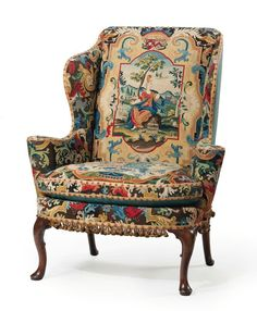 A George I Walnut and Beech Wing Armchair. Circa 1725, covered in 18th century gros and petit point needlework. Estimate: $60,000-90,000