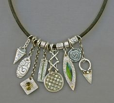 Mirinda Kossoff - fine silver (PMC) charm necklace with hand-made fine silver beads
