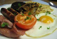 Traditional Scottish Breakfast -- black pudding, haggis, bacon, sausage, beans, eggs, mushrooms, tomato, potato scone, and toast