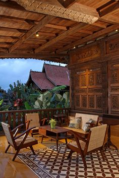 Indonesian Retro Furniture, Teak Carved Wall Panels, Batik Pillows.  Iwan Sastrawiguna Interior Design