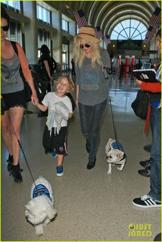 Ashlee Simpson departs a flight out of LAX Airport with her son Bronx on June 10, 2013