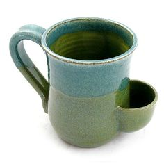 Stoneware Tea Mug with Tea Bag Pocket. A generously-sized handmade mug just for the tea lovers! Crafted with a special enclosed pocket to store your wet tea bag, so there's no need for a saucer. Individually made of durable stoneware clay with an attractive blue/green glaze, each mug is high fired for a permanent finish that is lead-free, microwave safe, and dishwasher safe. Tea Mug holds up to 16 ounces (2 cups).