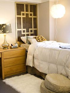 Budget-Friendly Headboards: Designer Kara Paslay made this headboard from a thin piece of stained luan for this small bedroom. She adorned the luan with spray-painted painter's tape in a geometric motif. The look is great for dorm rooms or guest bedrooms. From DIYnetwork.com