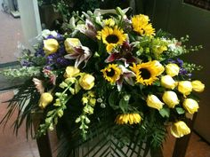 Sun flowers, roses, stargazer lily, snapdragon..