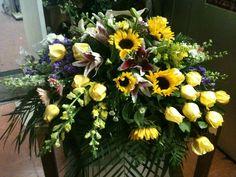 Sun flowers, roses, stargazer lily, snapdragon..