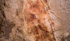 """Ancient paintings found in caves on Sulawesi may be the oldest artworks found outside Europe... """"It is often assumed that Europe was the centre of the earliest explosion in human creativity, especially cave art, about 40,000 ago,"""" Maxime says. """"But our rock art dates from Sulawesi show that at around the same time on the other side of the world people were making pictures of animals as remarkable as those in the Ice Age caves of France and Spain."""""""