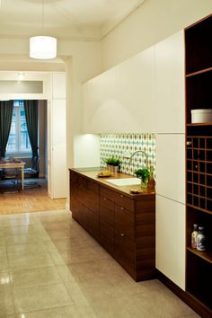 Former hallway converted into a very large kitchen. 100 square meter luxury apartment rental. Budapest, Hungary. Owned by Beck Real Estate Kft.