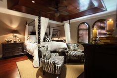 Bedroom Photos African Safari Decor Design, Pictures, Remodel, Decor and Ideas. If I ever choose a different draping for my Ethan Allen 4 poster, this could be considered. Tropical Master Bedroom, Tropical Bedrooms, Bedroom Photos, Bedroom Themes, Bedroom Decor, Zebra Bedrooms, Bedroom Ideas, Bed Ideas, Bedroom Designs