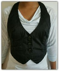 Black Vest -Ties In The Back. -Tie Is Leopard Print. -Faux Pockets. -Used In Good Condition. Jackets & Coats Vests