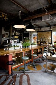 thegreyconcept: Industrial Design Cafe. Great cafe to park a Vespa outside