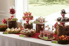 woodland gnome party, fern centerpieces, moss runner, red and white accents........ chunks of wood for food and things