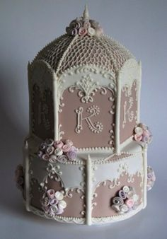 Two-tiered cake with 'K' initial, roses and filigree piping design