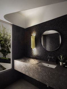 amazing bathroom lighting design ideas | A modern and minimalistic bathroom asks for a perfect light to go with it. And this amazing golden wall light is the ideal piece for a modern bathroom that works both as a mirror lamp and a delightful decorative piece.