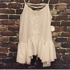 White flowy blouse Originally bought from anchored fashion but it just doesn't fit me quite right! Make offers :) not urban outfitters but NWT Urban Outfitters Tops
