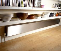 Kitchens often lack wall space, so very long low radiators such as the Lie Down work well under shelving.