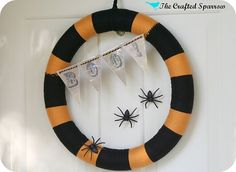 Like the idea of the wreath with BOO on  the bottom without the spiders!