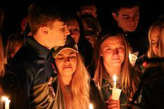 People attend a vigil for the victims of a fatal shooting at Marshall County High School on Jan. 25, at Mike Miller County Park in Benton, Kentucky. The 15-year-old shooting suspect, which left two dead and over a dozen injured, is being held on preliminary charges of murder and assault.