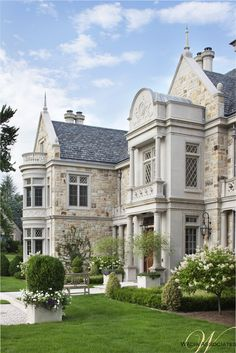See how the bones of the exterior utilize stone and architectural dealing to personalize a historically inspired design, creating a handsome silhouette.