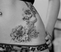 Flower hip tattoo...replaced by roses for my last name?