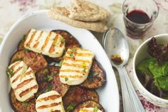 Ingredients Serves 4 2 medium aubergines, cut into slices about 6mm thick 450g halloumi cheese, drained and cut into slices slightly thicker than the aubergines 2-3 tbsp olive oil 4 tbsp chopped...