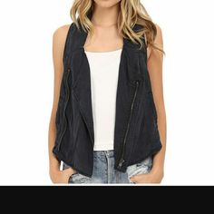 Free People Cutout Back Vest Moto inspired vest, collar less with asymmetrical zipper closure. Structured seaming throughout. Slip hand pockets. 100% Tencel . Length 19in. Color is charcoal grey Free People Jackets & Coats Vests