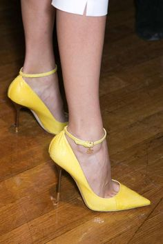 Backstage at DSquared2, Spring 2014 -- Yellow point-toed ankle strap pumps.