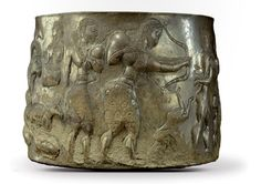 Silver cup with fighting scene , western Asia, ca. late 3rd-2nd millennium B.C.