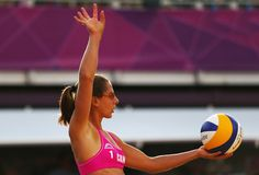 Annie Martin of Canada prepares to serve during the Women's Beach Volleyball Preliminary match between Great Britain and Canada on Day 2 of the London 2012 Olympic Games at Horse Guards Parade on July 29, 2012 in London, England.