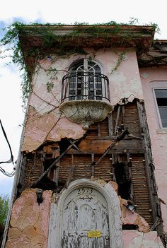 This abandoned beauty in New Orleans is the result of Hurricane Katrina and the floods.  Very sad.  It was obviously an incredible home.