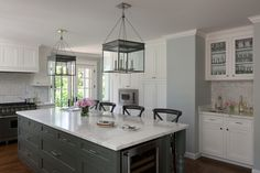 A Traditional Kitchen in Grey & White with Marble Countertop Island. Photo by Kathryn MacDonald