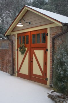 love these split doors and paint style on doors and garage trim details CUTE