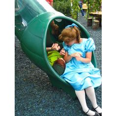 Peter Pan and Wendy in a slide