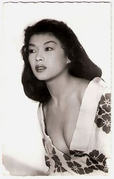 Porcelain pretty Yoko Tani (1928 – 1999) was a French-born Japanese actress and also a sensual nightclub entertainer. She appeared in many French films, but also played starring roles in Japanese, British, American, Canadian and even East-German productions.