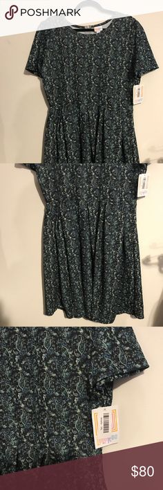 ➕ BNWT LLR 3x Amelia Navy w/ Green & Cream Paisley BNWT LuLaRoe 3x Amelia Dress Navy Background w/ Green & Cream Paisley. Amelia dresses have pockets, zippered backs, puff sleeves, and box pleated skirts. Gorgeous textured material and plenty of ways to style with belts, a matching cardigan, and more! PERFECT for all sorts of events - Valentines Day, a wedding shower, or Easter! LuLaRoe Dresses
