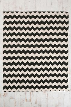 I'm trying not to fall into the chevron craze, but if I can't get the rug I want, I may have to.  Need something geometric in the kitchen