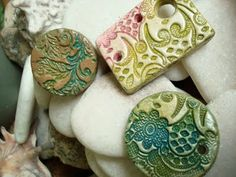 Pendants made from air dry clay LOOKS LIKE ANOTHER FUN PROJECT.