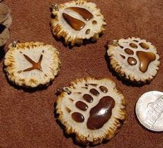 Small track carvings in antler by Jack Brown, similar to ones he sold on eBay