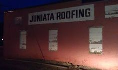 Juniata Roofing ghost sign in Juniata, NE