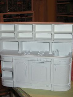 FANTASTIC SITE!!! Tutorials & directions for: Barbie House Re-furbished Wicker Barbie furniture Re-furbished Antique Barbie Hutch Re-furbished Barbie's Kitchen Shabby Chic Bedroom How to lay wood flooring Make a Faux Brick floor Make a three tiered miniature table out of Illustration Board Make Faux bricks Make a Barbie Size Christmas tree New couch and chair