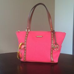 ✨NWT✨ Michael Kors Jet Set Studded Tote Watermelon NWT! Authentic Michael Kors Jet Set Studded Tote in Watermelon. This tote is Fabric material with a gold studded leather trim. Length is 10 inches at the base(bottom) and 16 inches at the top(where the opening of the bag is), 5 inches width, and 10 inches height. Exterior side pockets. Interior has 4 cell pockets and one large zip pocket. Zipper closure. Gold hardware. ***NO TRADES OR PAYPAL-PLEASE DO NOT ASK!*** MICHAEL Michael Kors Bags…