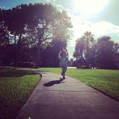 little girl running with backlighting