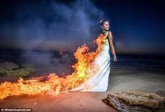 I don't think I have the skill to pull this off... but we could try to figure it out Set fire to your dress while wearing it | Community Post: 28 Ways To Trash Your Wedding Dress