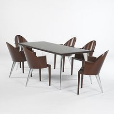 PHILIPPE STARCK    dining set    Driade  France, 1988  cherry, pearwood, aluminum  83 w x 35 d x 28 h inches  chairs: 22 w x 21 d x 33.75 h