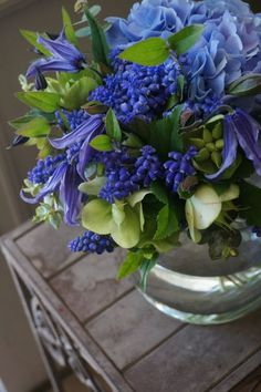 If you want a blue wedding.these are lovely choices: clematis,muscari and hydrangea 🌹 ᘡℓvᘠ❉ღϠ₡ღ✻↞❁✦彡●⊱❊⊰✦❁ ڿڰۣ❁ ℓα-ℓα-ℓα вσηηє νιє ♡༺✿༻♡·✳︎· ❀‿ ❀ ·✳︎· TH OCT 2016 ✨ gυяυ ✤ॐ ✧⚜✧ ❦♥⭐♢∘❃♦♡❊ нανє α ηι¢є ∂αу ❊ღ༺✿༻✨♥♫ ~*~ ♪ ♥✫❁✦⊱❊⊰●彡✦❁↠ ஜℓvஜ 🌹 Blue Flowers Bouquet, Blue Wedding Flowers, Table Flowers, Flower Bouquet Wedding, Green Flowers, Beautiful Flowers, Purple Bouquets, Bridesmaid Bouquets, Peonies Bouquet