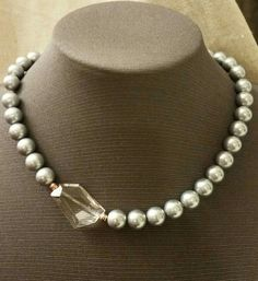 Single strand glass pearl and glass crystal necklace. This necklace is made of large grey glass pearls and one quartz-look asymmetrical glass crystal. Pearl Necklace Designs, Pearl And Diamond Necklace, Cultured Pearl Necklace, Glass Necklace, Gemstone Necklace, Pearl Jewelry, Bridal Jewelry, Beaded Jewelry, Jewelery