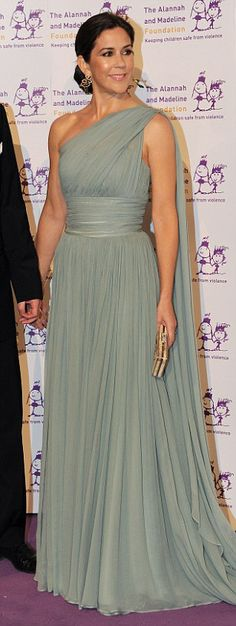 wears one-shouldered Grecian gown for a charity dinner in 2011--Crown Princess Mary of Denmark has been voted Most Stylish Young Royal in a poll of Hello! readers FEMAIL look back at her best fashion moments, August 17, 2015