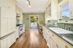 Kitchen with nice tile, pulls, cabinets, light fixtures. Too bad about the granite--blech. Green Lake Area Residential